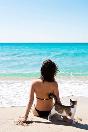 Girl on the beach with a kitten photo