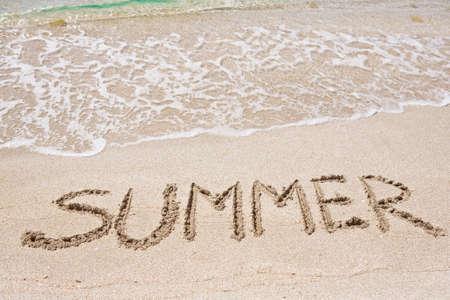 Summer written on the sand Standard-Bild