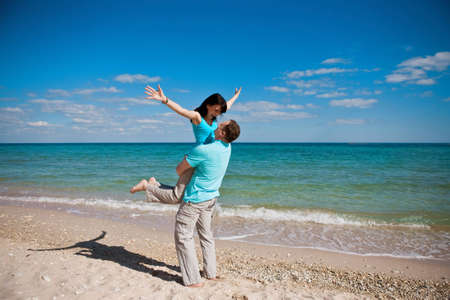 man woman hugging: Couple on beach Stock Photo