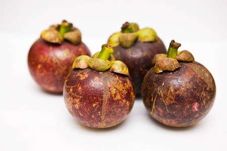 Four Mangosteens on white background photo