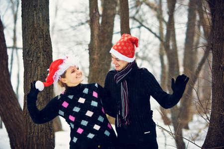 Lovers in Christmas hats photo