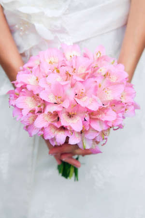 Bridal bouquet in the hands of the bride Stock Photo