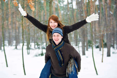 Young couple in love smiling in winter