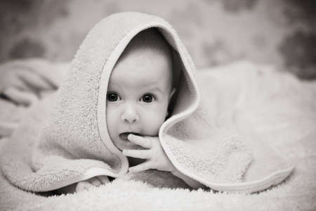 Small child under a towel