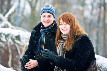 Young couple in love smiling in winter photo
