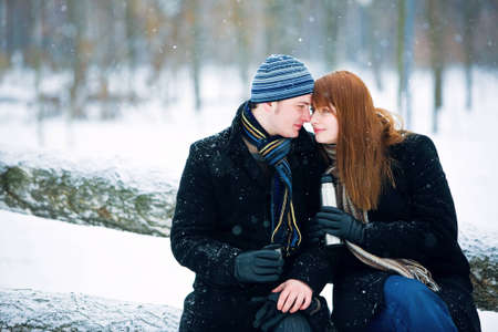 winter couple: Young couple in love smiling in winter