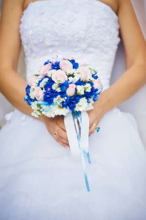 Bridal bouquet in the hands of the bride photo