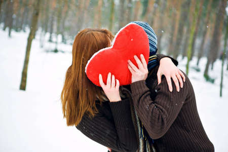 Couple with heart kissing photo