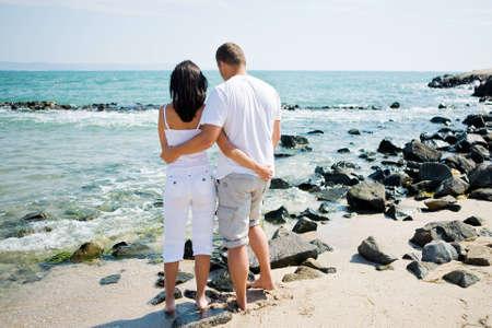A couple hugging on beach