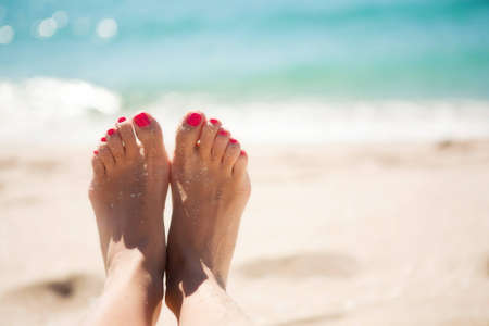 pedicure: Girls feet in the sand