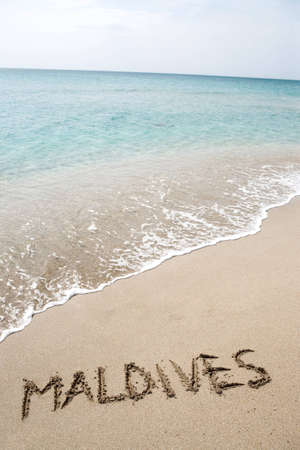 Maldives written on the sand Stock Photo - 10945137