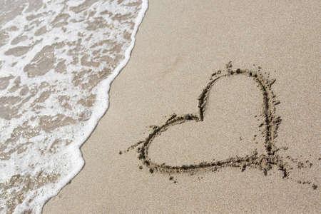 One heart drawn in the sand Standard-Bild