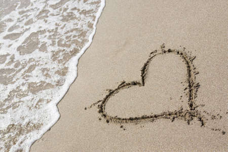 heart on the sand: One heart drawn in the sand Stock Photo