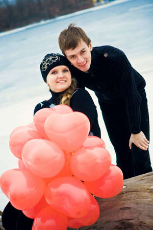 Couple in love with a red heart-balls