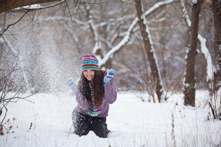 Girl in winter forest fun Stock Photo