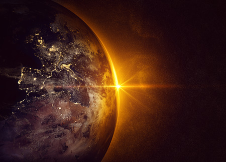 outer space: Sunrise and earth