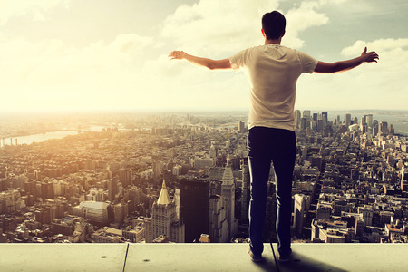 prevail: Man enjoys view over Manhattan