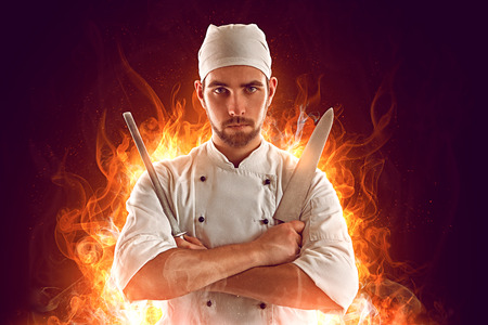 sharpen: Serious Chef on fire Stock Photo