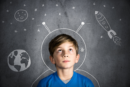 dream job: little boy dreaming Stock Photo