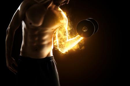 Brandende Spieren Stockfoto