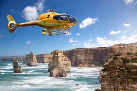Helicopter over the 12 Apostles, Australia Stock Photo - 75167239