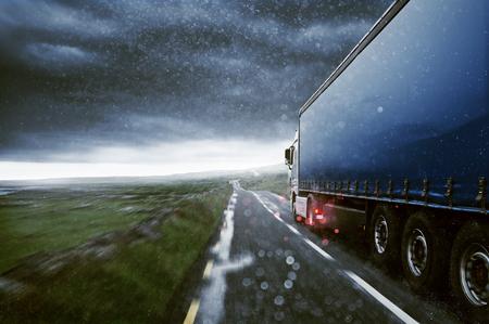 Truck drives through the rain Banco de Imagens