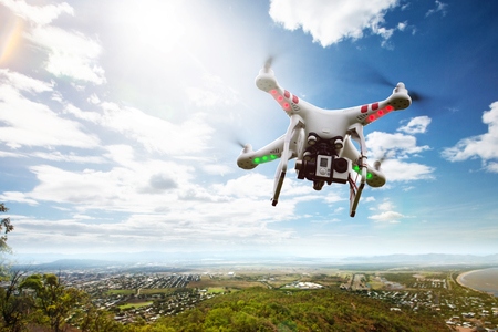 Drone flies above Landscape Stock Photo