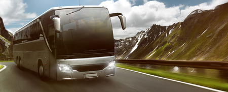 Bus in front of mountain landscape
