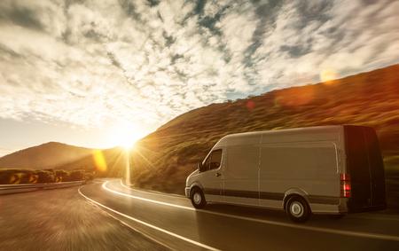 Delivery van on a country road Foto de archivo