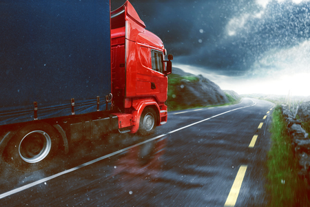Truck drives during rain