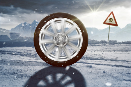 Rolling Winter Tire Stock Photo