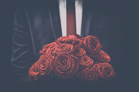 red  man: Man offers a bouquet of roses