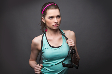 Sporty Woman with Stretch Band Stock Photo
