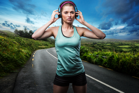 Female Runner with Headphones Banco de Imagens - 75688760
