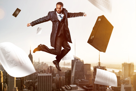 Jumping Businessman in front of New York City