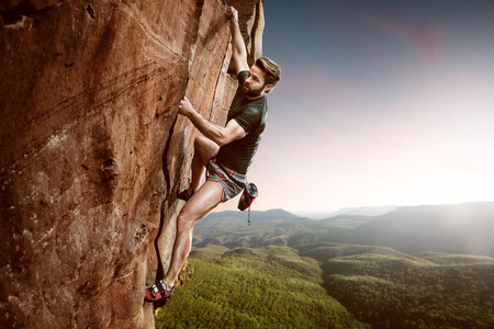 Climber on a cliff Stock Photo