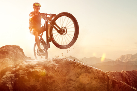 Mountainbiker performs a Wheelie Stock Photo