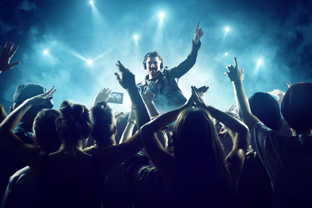 omitted: Dj in front of crowd Stock Photo