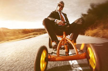 Confident Businessman on Pedal Car