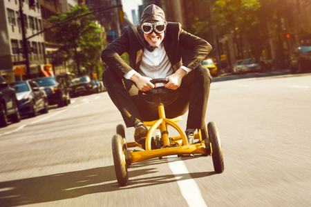 Businessman on a pedal car