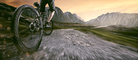 Mountainbiker goes uphill Stockfoto