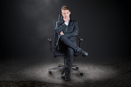 Boss posing on a chair