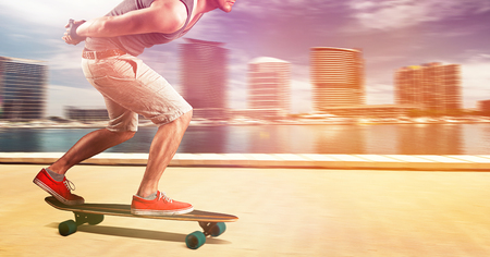 Longboarder skating fast Stock Photo - 93563124