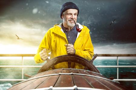 yellow dressed Steersman on ship