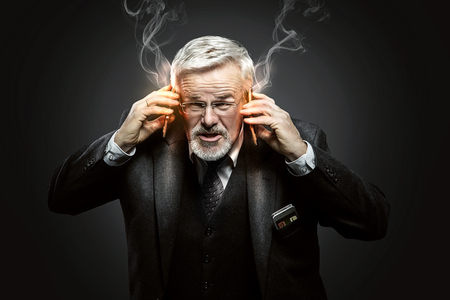 important phone call: Businessman with some Mobile Phones Stock Photo