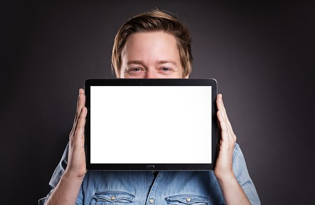 uphold: Guy holding a Tablet PC