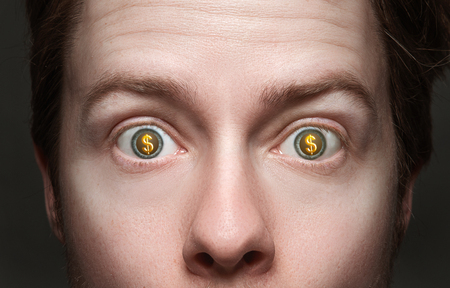 earn money: Man with dollar signs in his eyes Stock Photo