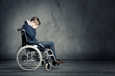 Sad man in wheelchair Stock Photo