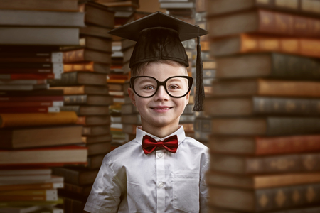 Toddler between books Stock Photo