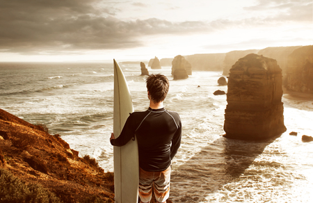 Surfer enjoys the view over the bay